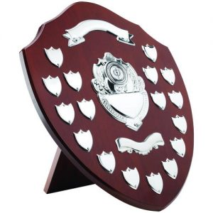 MAHOGANY SHIELD WITH CHROME FRONTS AND 17 RECORD SHIELDS (1in CENTRE) – 16in