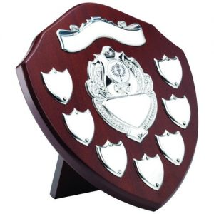 MAHOGANY SHIELD WITH CHROME FRONT AND 7 RECORD SHIELDS (1in SHIELD) – 9in