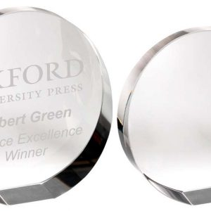 CLEAR GLASS ROUND WEDGED PAPERWEIGHT